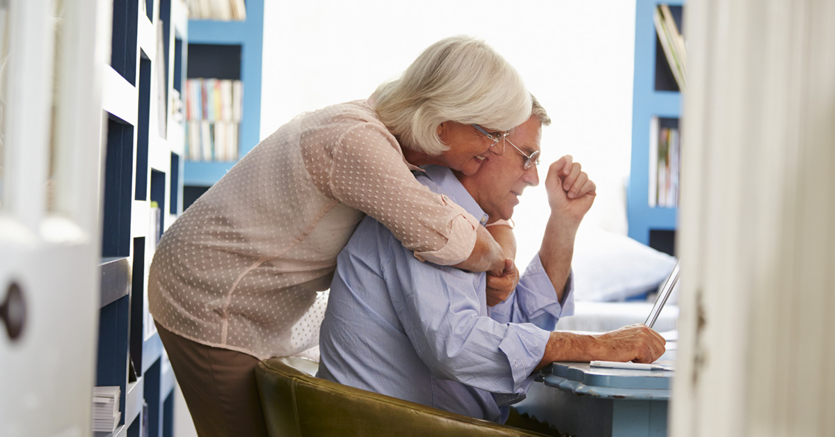 Image Of A Senior Husband And Wife Looking Over Bills.