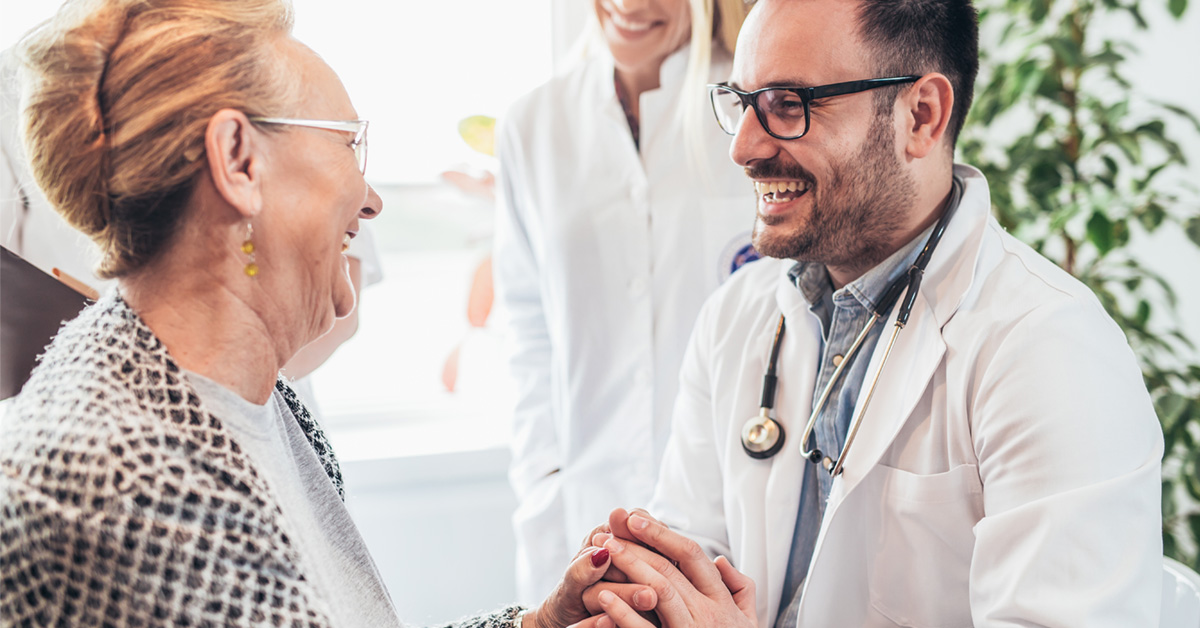 A Doctor Discussion Care With A Senior Patient